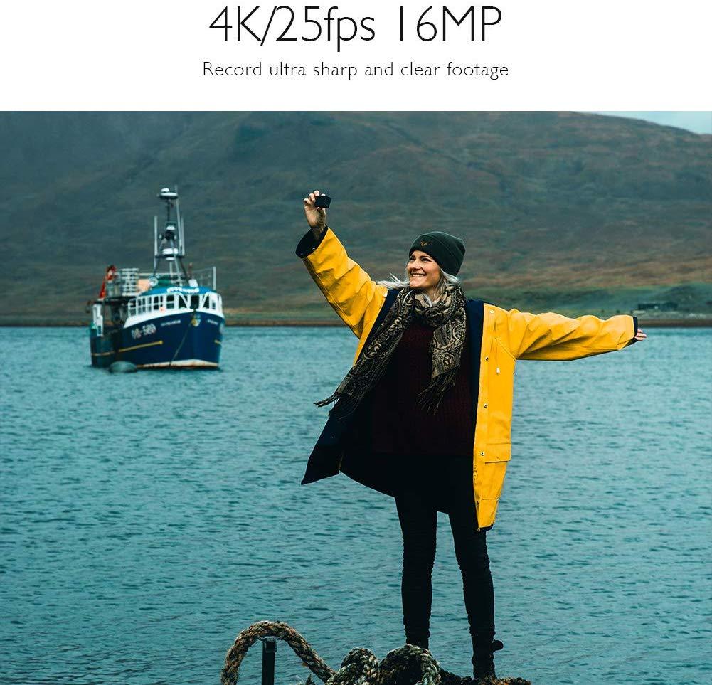Una mujer estaba junto al lago grabando un video en su cámara de acción AKASO EK7000